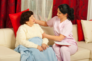 caregiver comforting old woman